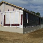 View of home with insulated skirting installed - an option that is available to purchase with all manufactured homes
